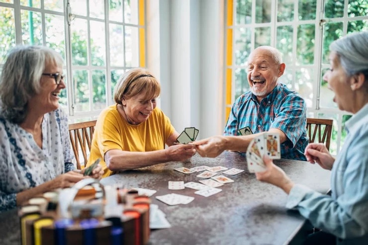 Elderly group playing a game of cards